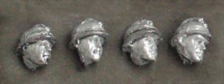 Set of four heads in Adrian helmets; 28 mm