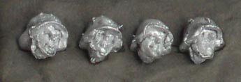 Set of four heads in German helmets; 28 mm